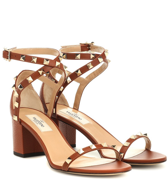 Valentino Garavani Rockstud leather sandals in brown