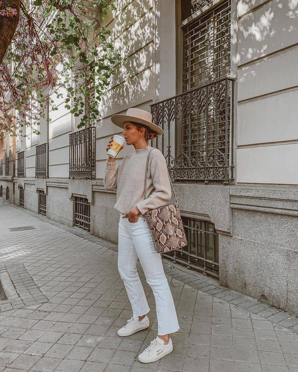 jeans white jeans cropped jeans flare jeans white sneakers snake print bucket bag sweater felt hat