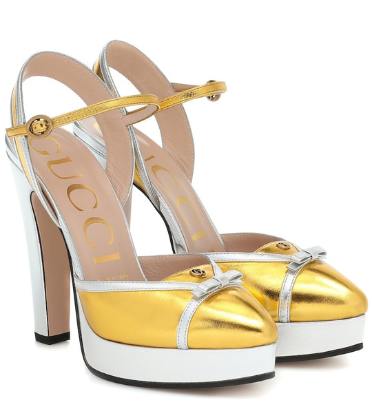 Gucci Leather plateau pumps in gold