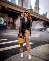 bag,yellow bag,handbag,white boots,cargo pants,high waisted pants,black blazer,black sunglasses