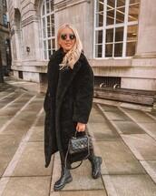 coat,faux fur coat,black boots,chanel bag,black turtleneck top,joggers