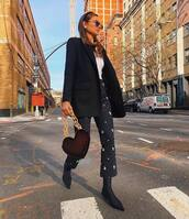 pants,flare pants,sock boots,black boots,shoulder bag,black coat,white top