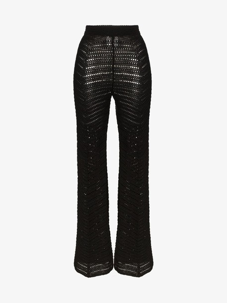 Situationist Zig-zag knit flared wool trousers in black