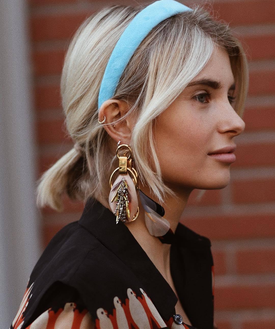 hair accessory headband aqua gold earrings feathers black shirt