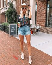 top,black t-shirt,the rolling stones,ankle boots,white boots,denim shorts,hat,bag
