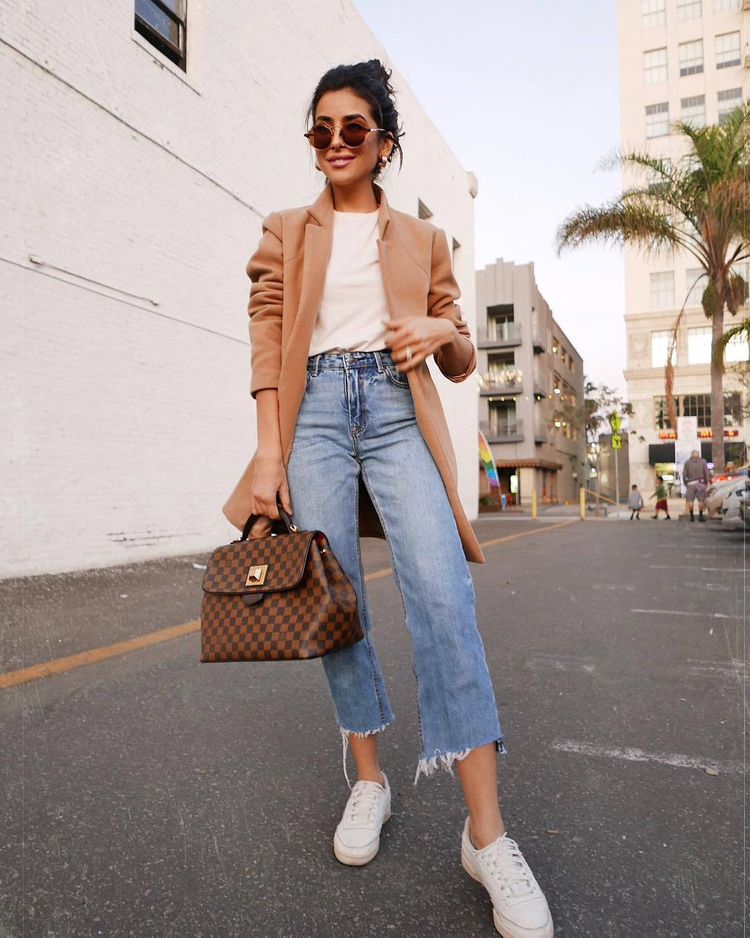 jeans ripped jeans cropped jeans white sneakers handbag louis vuitton coat white t-shirt
