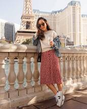 shoes,white sneakers,red skirt,midi skirt,floral skirt,denim jacket,black bag,white sweater,sunglasses