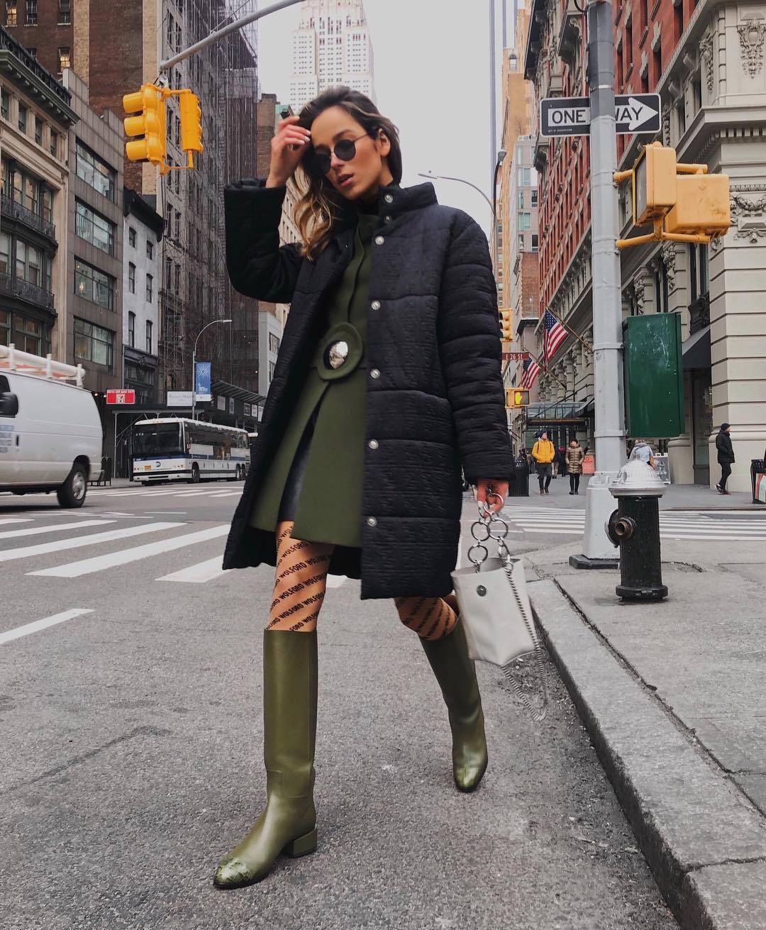 shoes knee high boots green boots tights white bag handbag black jacket puffer jacket green coat mini skirt black skirt leather skirt