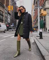 shoes,knee high boots,green boots,tights,white bag,handbag,black jacket,puffer jacket,green coat,mini skirt,black skirt,leather skirt