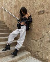 jeans,white jeans,oversized,black boots,black shirt,black top,crop tops,belt bag