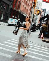 shorts,midi skirt,asymmetrical skirt,white skirt,polka dots,sandals,black top,crop tops,black bag
