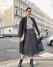 coat,long coat,black coat,black boots,ankle boots,heel boots,midi skirt,black skirt,pleated skirt,white shirt,black bag