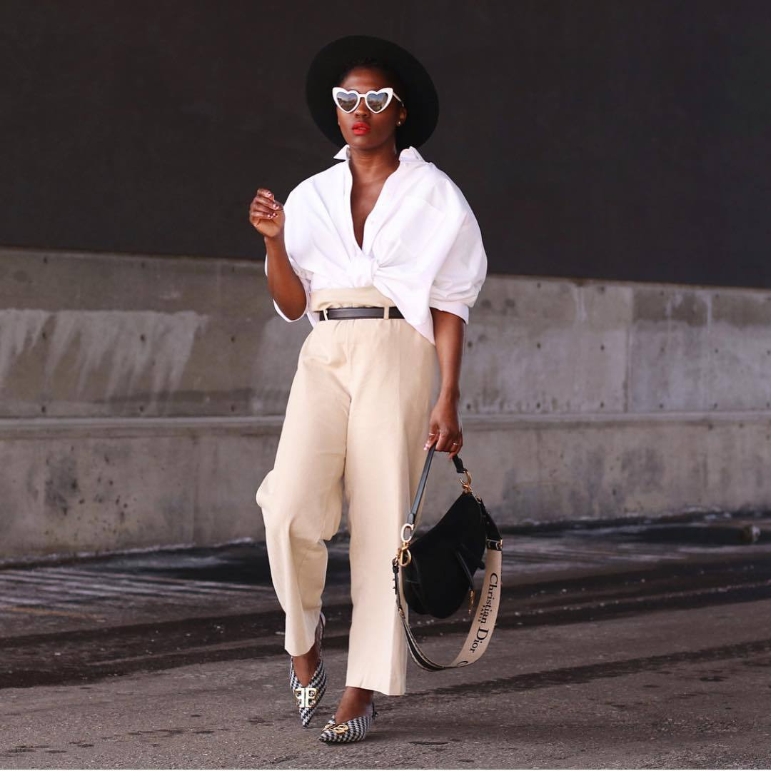 top white shirt oversized shirt high waisted pants straight pants black belt pumps balenciaga black bag dior bag hat sunglasses