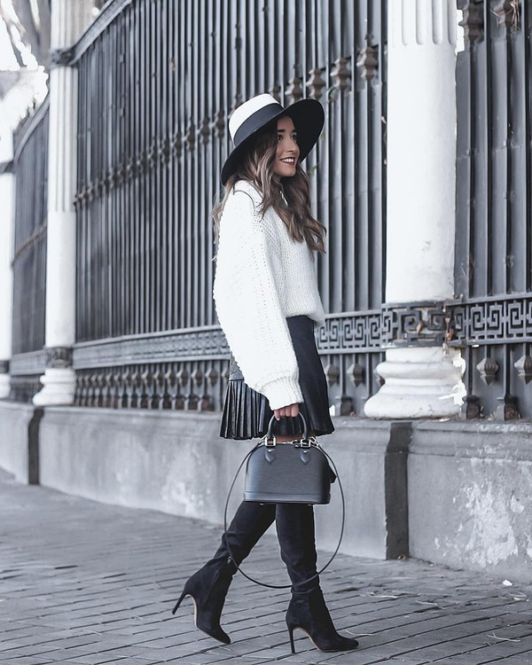 sweater knitted sweater white sweater puffed sleeves knee high boots black heels black bag shoulder bag louis vuitton bag black skirt mini skirt pleated skirt felt hat