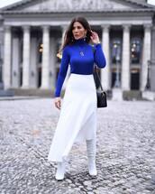 skirt,midi skirt,asymmetrical skirt,white skirt,white boots,heel boots,knee high boots,turtleneck,shoulder bag