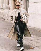 coat,trench coat,long coat,double breasted,sneakers,black leather pants,straight pants,high waisted pants,black sweater,white bag