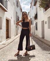 pants,black pants,flare pants,high waisted pants,black top,sleeveless top,louis vuitton bag,slide shoes