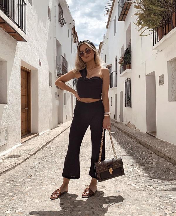 pants black pants flare pants high waisted pants black top sleeveless top louis vuitton bag slide shoes