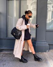 sweater,black hoodie,black boots,chanel bag,black bag,trench coat