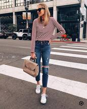 top,striped top,white sneakers,high waisted jeans,skinny jeans,ripped jeans,shoulder bag,black sunglasses,streetstyle