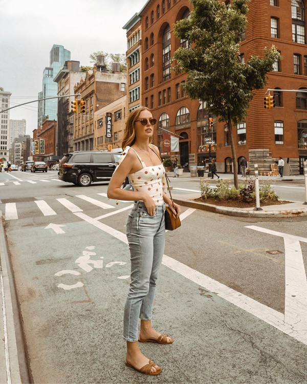 top tank top white top floral high waisted jeans skinny jeans slide shoes brown bag