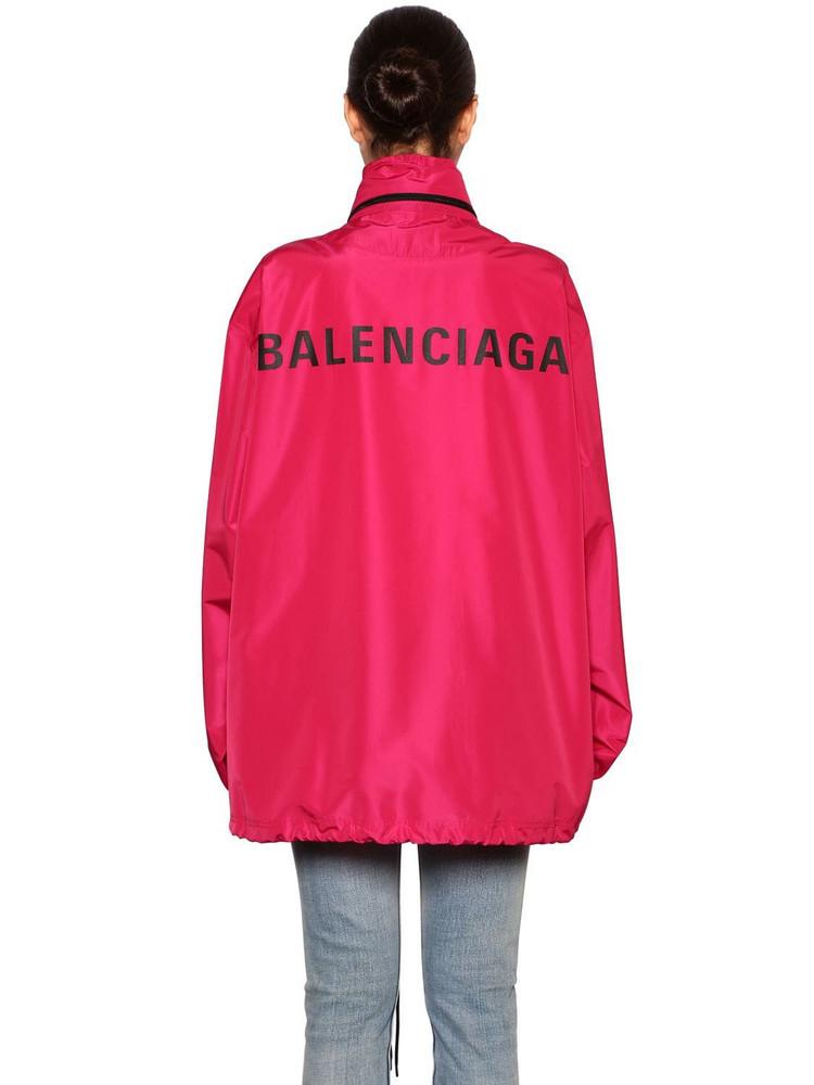 BALENCIAGA Back Logo Hooded Nylon Windbreaker in fuchsia