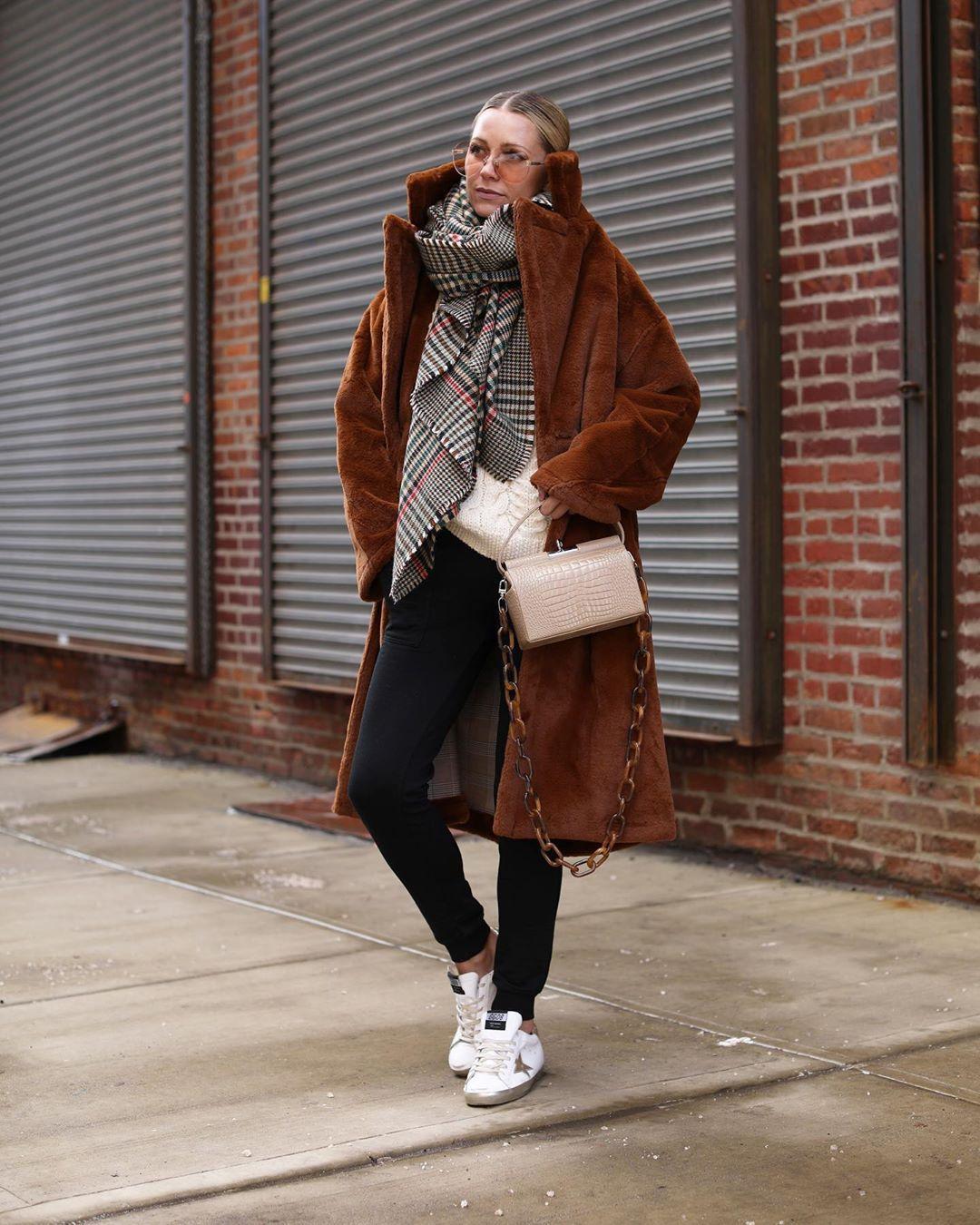 coat faux fur coat brown coat white sneakers black skinny jeans white bag boxed bag white sweater plaid scarf