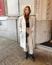 coat,long coat,black boots,lace up boots,high waisted,pants,black top,crossbody bag,black bag