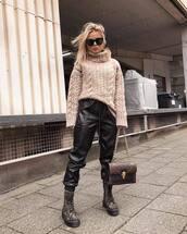 sweater,turtleneck sweater,platform boots,ankle boots,camouflage,leather pants,black pants,louis vuitton bag,brown bag,cable knit