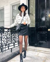 sweater,white sweater,polka dots,ankle boots,black boots,black skirt,black leather skirt,black bag,hat