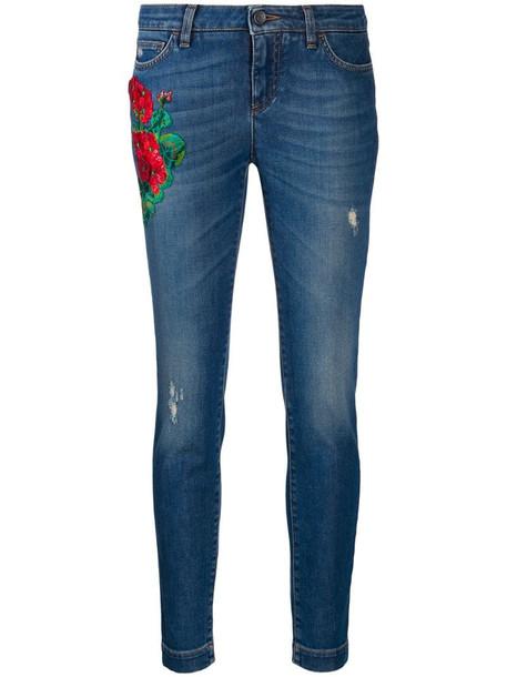 Dolce & Gabbana floral appliqué skinny jeans in blue