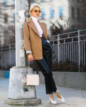 pants,black leather pants,high waisted pants,pleated,straight pants,white shoes,slingbacks,white bag,shoulder bag,beige coat,white turtleneck top,sunglasses