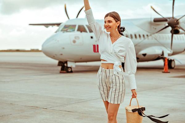 the mysterious girl blogger shirt shorts bag sunglasses