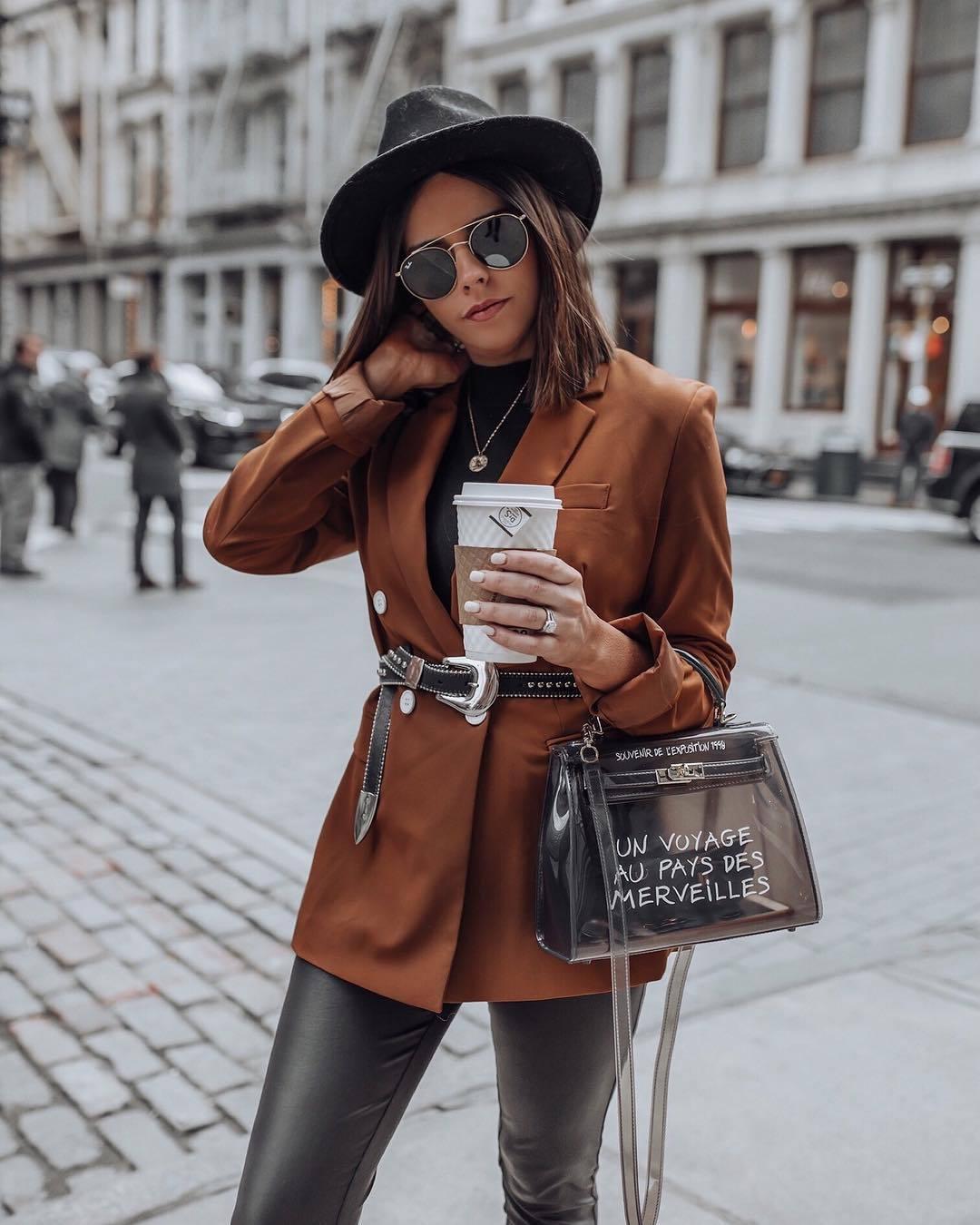jacket blazer double breasted brown black belt black leather pants pvc bag black turtleneck top hat