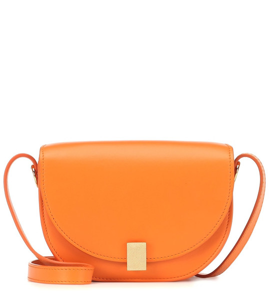 Victoria Beckham Half Moon Nano leather crossbody bag in orange