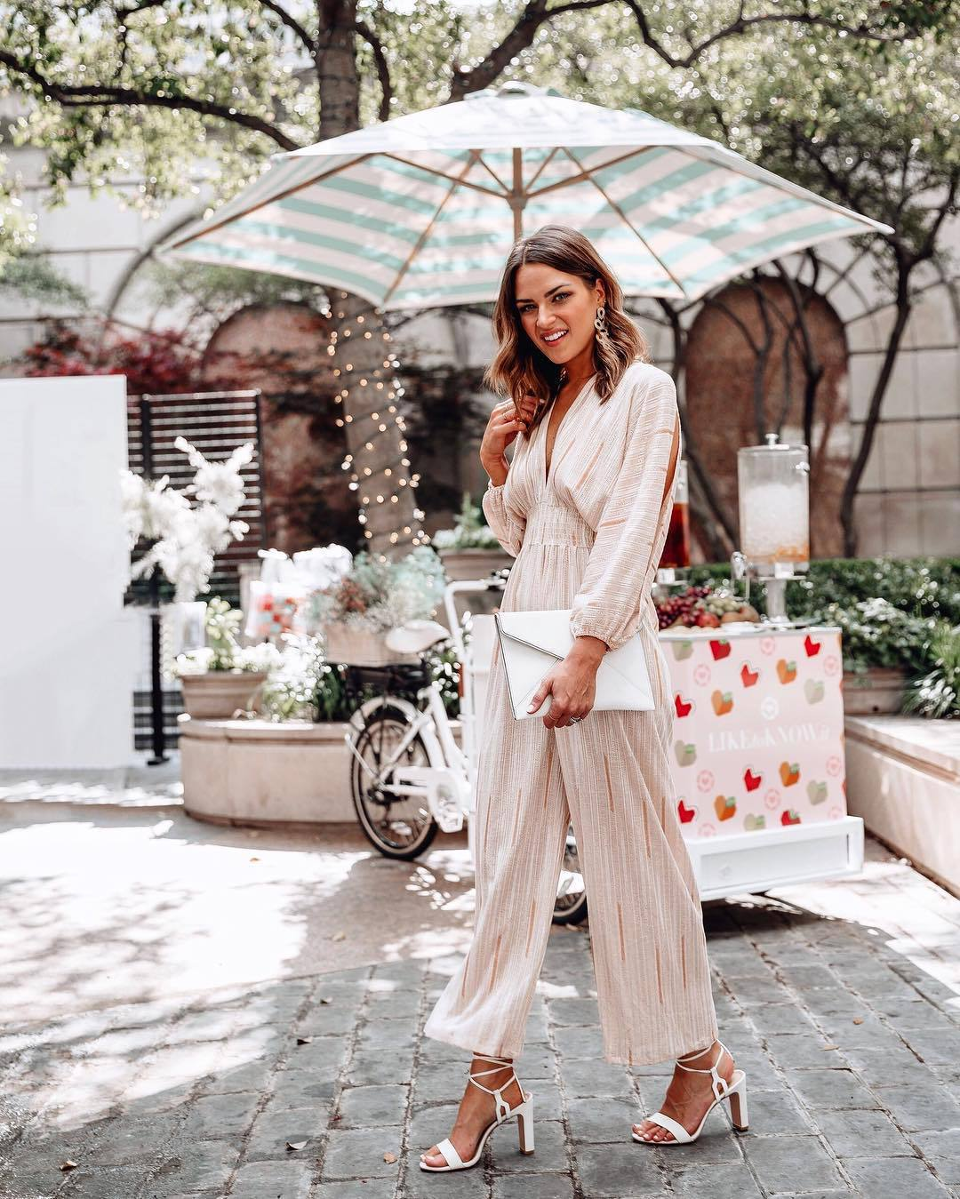 jumpsuit long sleeves v neck white sandals white bag