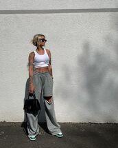 pants,joggers,wide-leg pants,sneakers,black bag,white top,tank top