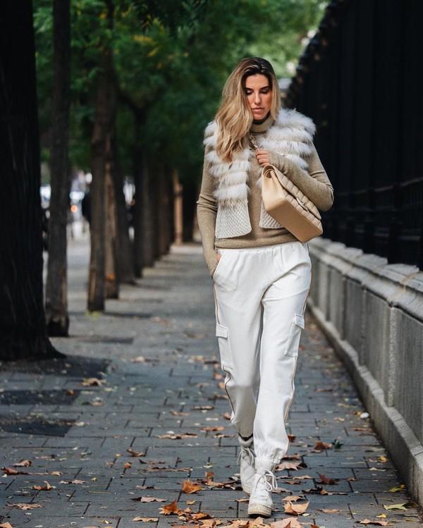 pants white pants cargo pants sneakers turtleneck sweater crossbody bag