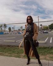 jumpsuit,black jumpsuit,long sleeves,black boots,black bag,shoulder bag,camel coat,long coat