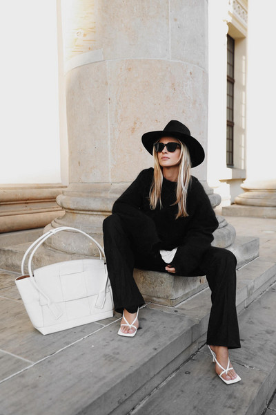 mija blogger sunglasses hat t-shirt pants sweater jewels bag shoes black and white white sandals white bag black sweater