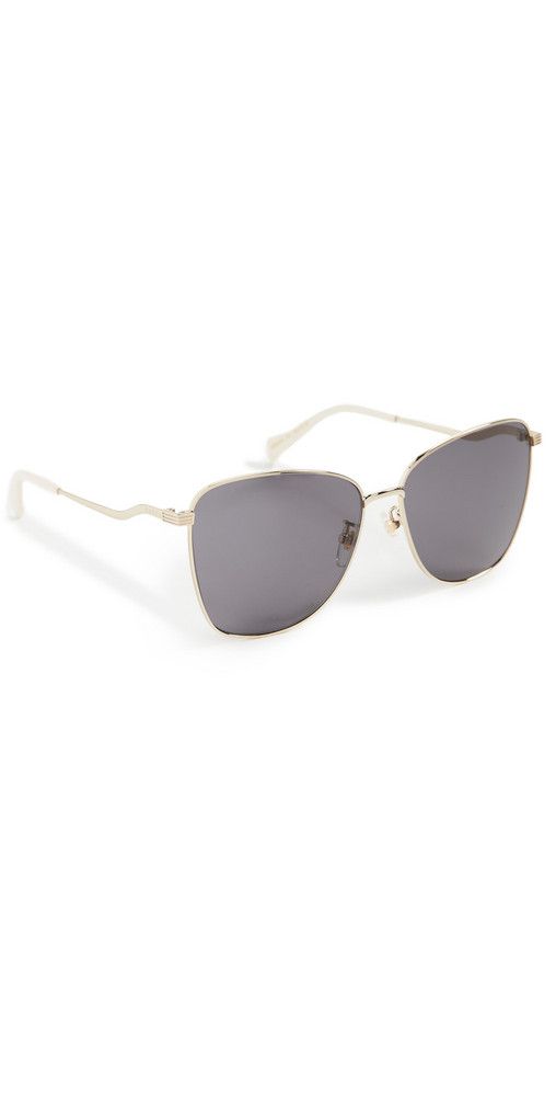 Gucci Metal Wave Sunglasses in gold / grey