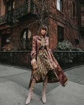 coat,red coat,long coat,knee high boots,heel boots,asymmetrical dress,floral dress,long sleeve dress,black belt,tights