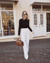 pants,white pants,wide-leg pants,white boots,brown bag,black sweater