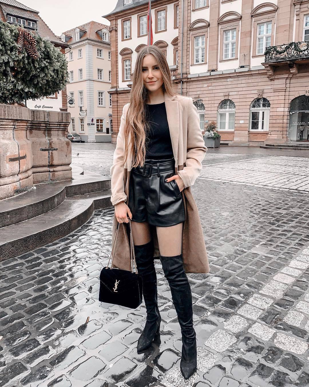 shorts leather shorts black boots over the knee boots ysl bag camel coat black top