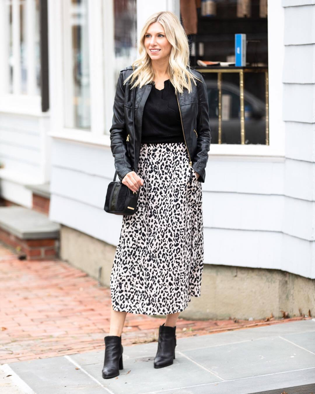 shoes ankle boots heel boots leopard print midi skirt black and white leather jacket black top black bag