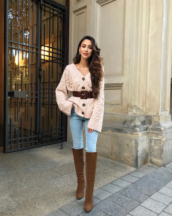 sweater cardigan skinny jeans knee high boots brown boots belt