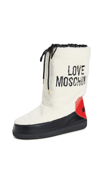 Moschino Shearling Snow Boots in natural / red