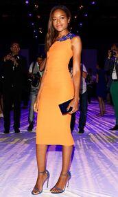dress,bodycon dress,orange dress,sandals,naomie harris,clutch,victoria beckham,victoria beckham dress,prom shoes