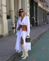 dress,white dress,asymmetrical dress,long sleeve dress,belt,knee high boots,white boots,handbag,green bag