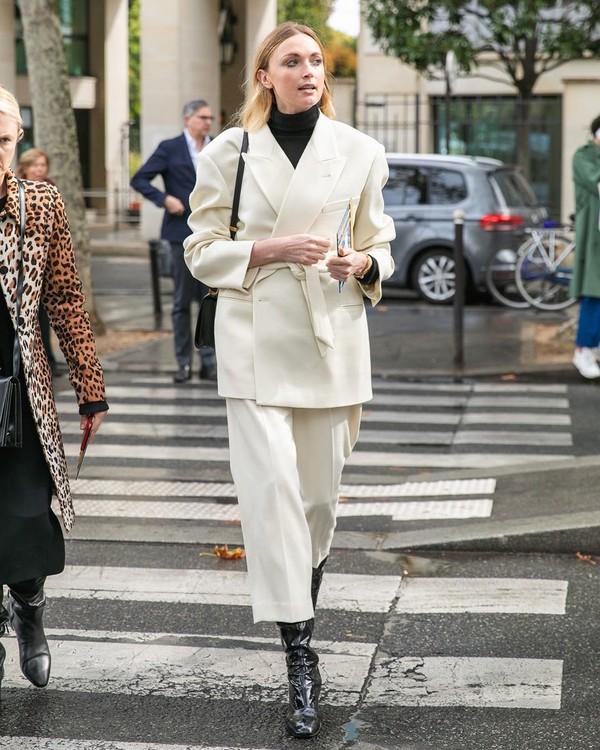 jacket white blazer wide-leg pants black boots turtleneck black bag